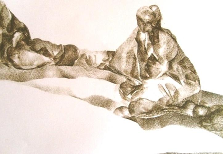 Femme assise dans le désert 0